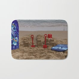 sandcastles, boards, buckets and spades at the beach Bath Mat