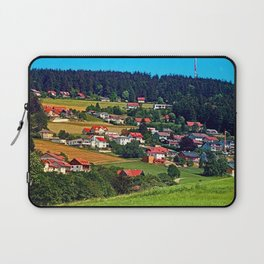 Green grass, the village and a transmitter pole Laptop Sleeve