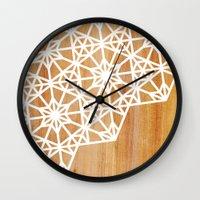 Wall Clocks featuring Frozen Stars by Jenna Mhairi