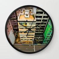 hong kong Wall Clocks featuring Hong Kong by Gal Raz