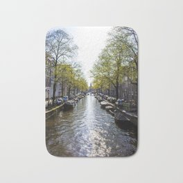 Sun Shining on a Row of Spring Trees Lining the Keizersgracht Canal in Amsterdam, Netherlands Bath Mat