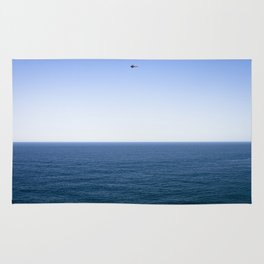 Classic plane over the ocean Rug