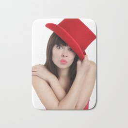 surprised woman with red top hat isolated on white background Bath Mat