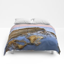 """Volcanic sea at pink sunset"" Comforters"