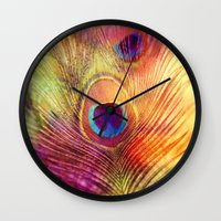 peacock feather Wall Clocks featuring peacock feather by Sylvia Cook Photography