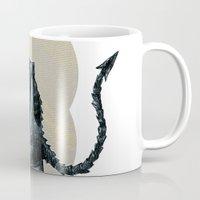 ali gulec Mugs featuring Ali rocks by jenapaul