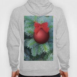 Red Christmas bauble on a fir tree Hoody