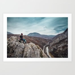 Girl sitting on the bench on the edge of the canyon with amazing view in front of her Art Print