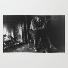 Vintage Adirondacks: Man Reading by the Fireplace Rug
