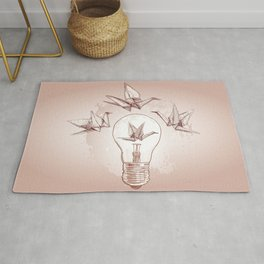 Origami paper cranes and light Rug