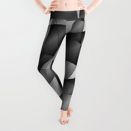Exclusive monochrome pattern of chaotic black and white fragments of glass, metal and ice floes. Leggings