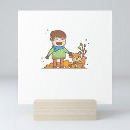 Happy kids character playing in autumn season1 Mini Art Print
