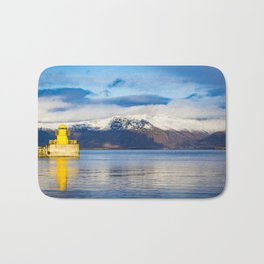 Small, Yellow Lighthouse in Front of Mountain in Reykjavik, Iceland Bath Mat