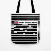 korea Tote Bags featuring North Korea News Paper by pollylitical