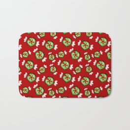 Cute lovely sweet decorative red and green candy pattern on Christmas red background. Bath Mat