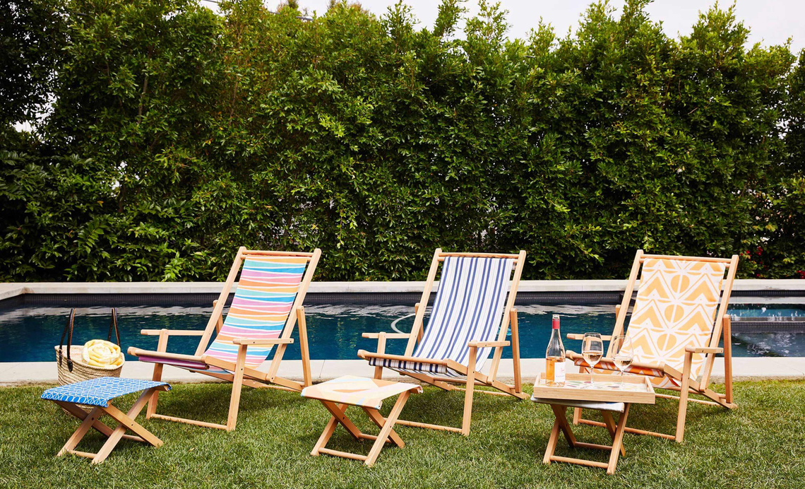 sling chairs by a swimming pool