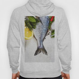 fresh dorado fish and vegetables on wooden board Hoody
