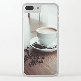 A cup of hot cappuccino placed on a wooden table near with coffee beans Clear iPhone Case