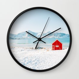 Red cabin on the beach with snow in the Lofoten Islands, Norway Wall Clock