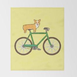 Corgi on a bike Throw Blanket