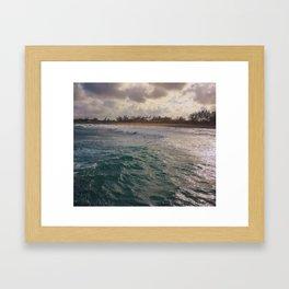 Stormy Coastline, rain clouds and sunlight Framed Art Print