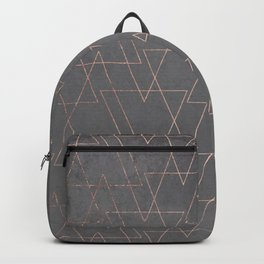 Modern rose gold geometric triangles blush pink abstract pattern on grey cement industrial Backpack
