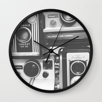 cameras Wall Clocks featuring CAMERAS by Tracey Sawatzky
