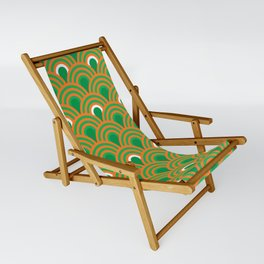 retro sixties inspired fan pattern in green and orange Sling Chair