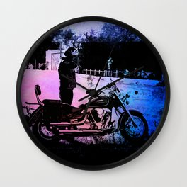 Biker with his motorcycle in a surreal landscape Wall Clock