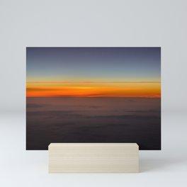 Sunrise over clouds Mini Art Print
