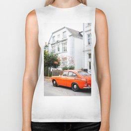 Car and orange Biker Tank