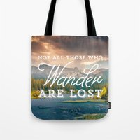 not all those who wander are lost Tote Bags featuring Not All Those Who Wander Are Lost by Crafty Lemon