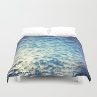 racing Duvet Covers featuring Racing Clouds by Luci Dreams