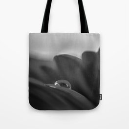 Alone is a black and white photograph water drop on flower Tote Bag