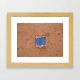 window in the mud Framed Art Print