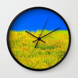 yellow poppy flower field with green leaf and clear blue sky Wall Clock