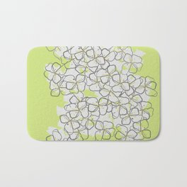 White Abstract Flower Pattern on Lime Green Background Bath Mat