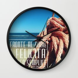 in front of the sea happiness is a simple idea Wall Clock