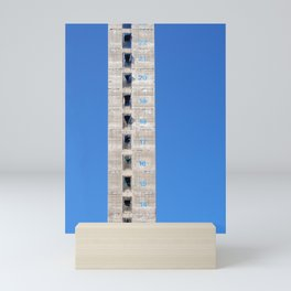 concrete and sky - tall tower under construction Mini Art Print