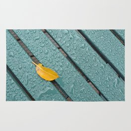 Yellow Leaf On A Green Bench With Rain Droplets Rug