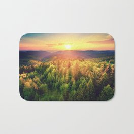Sunset over forest Bath Mat