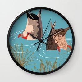 Ducks taking a bath Wall Clock