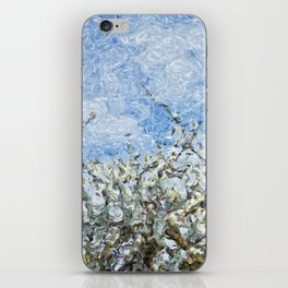 Soft spring white flowers against blue sky iPhone Skin