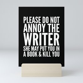 Please do not annoy the writer. She may put you in a book and kill you. (Black & White) Mini Art Print