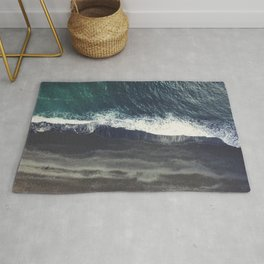 The black sand beach in Iceland. Aerial view and top view. Beautiful natural ocean photo Rug