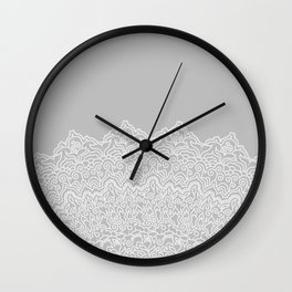 Detailed white lace like mandala in white with light grey background Wall Clock