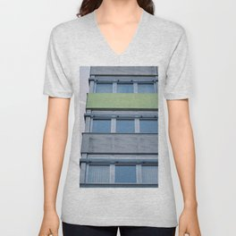 Building with a contrail in the sky Unisex V-Neck