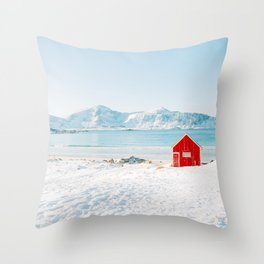Red cabin on the beach with snow in the Lofoten Islands, Norway Throw Pillow
