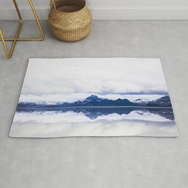 Navy blue Mountains Against Lake With Clouds Rug