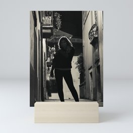 Silhouette of a woman in a little alley during the night Mini Art Print